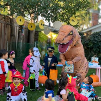 Mr. Dinosaur-handing-out-goodie-bags-at-the-Halloween-party